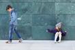 child throws plastic bottle