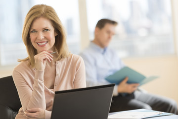 Confident Businesswoman Smiling In Office