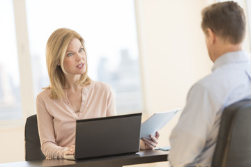 Businesswoman Taking Interview Of Male Candidate