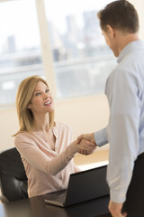 Businesswoman Greeting Candidate During Interview