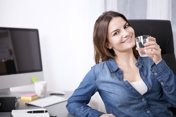 Office Woman on her Chair with Glass of Water