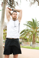 man doing stretching in the park