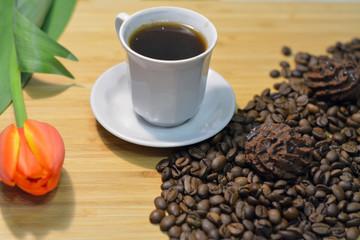 black coffee, truffel sweets on coffee beans