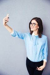 Happy businesswoman making selfie photo