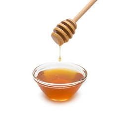 Honey drops of a honey dipper in a shell