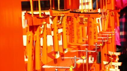 Small praying torii cards at the Fushimi Inari Shrine in Kyoto,