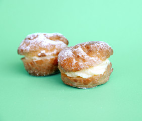 cream puff with filling and powdered sugar topping