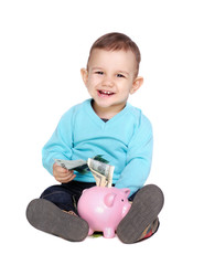 baby boy sitting on the floor with a piggy bank