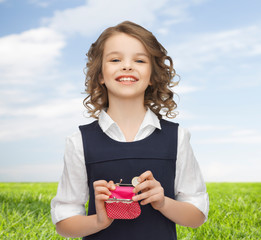 happy girl with purse and euro coin money