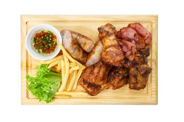 Restaurant food isolated - grilled meat assortment served on woo