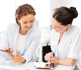 business team working with tablet pc in office