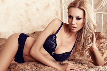 beautiful sexy woman with blond hair in lace lingerie