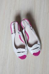 Summer womens fashion sandal on white wooden background