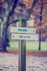Direction Sign for To Die and To Live Concept