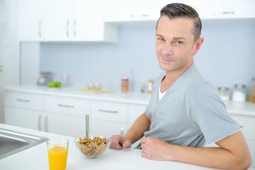 Bachelor eating breakfast alone