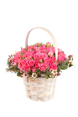 beautiful bouquet of pink roses in basket isolated on white back
