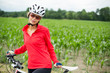 Pretty, young female biker outdoors on her mountain bike