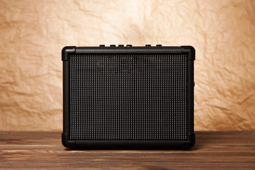 Guitar amplifier on yellow background