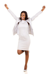 young african american businesswoman arms up