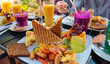 Colorfully covered brunch table at an outdoor cafe - 80805966