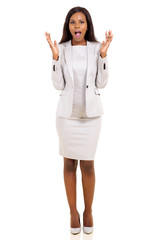 african businesswoman looking surprised