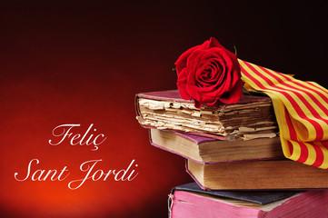 books, red rose and the text Felic Sant Jordi, Happy Saint Georg