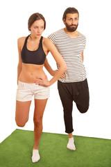 Exercising couple leg stretch