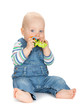 Small baby boy holding a toy