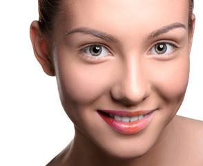 Close up head shot of beautiful young woman looking at the