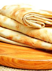 Lavash, tortilla wrap Bread on the cutting board on white