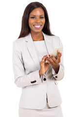 young african businesswoman holding smart phone