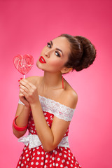Happy Woman Holding red Lollipop Shape of Heart. Pin-up retro