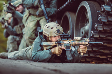 Soldier aim at a target of weapons