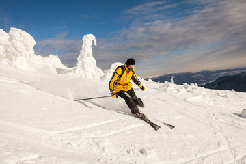 Man Snow Skiing Against Blue Sky