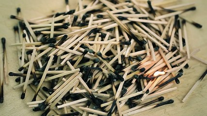 Burnt matches stack on wood