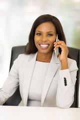 businesswoman talking on smart phone in office