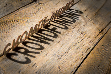 Wooden letters build the word crowdfunding