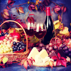 Beautiful still life with wine glasses, grapes, pomegranate and