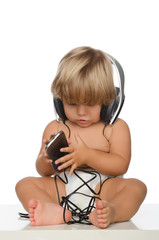 Attentive child with headphones and smartphone