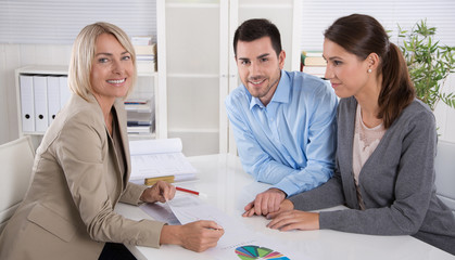 Professional business meeting: young couple as customers and an