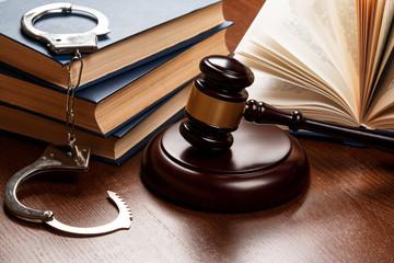 Gavel, books and handcuffs