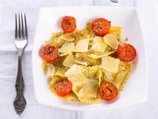Italian homemade ravioli pasta with tomatoes