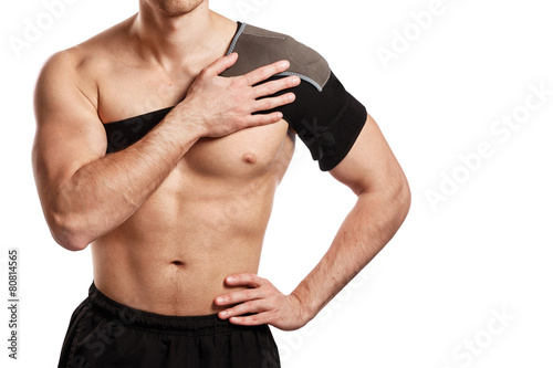 Sportsman with a support bandage on his shoulder - 80814565