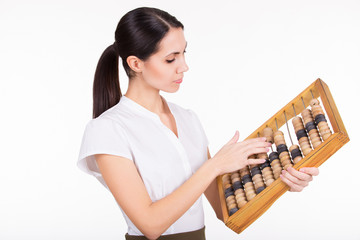 Business woman calculating finance with abacus