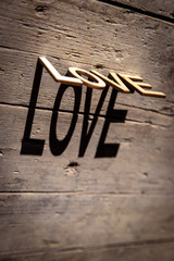 Wooden letters build the word Love