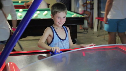 child playing air hockey, joy and emotion, 1080p HD video