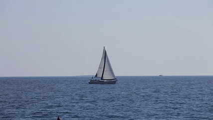 The yacht floats in the sea