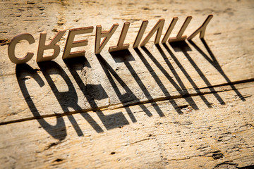 Wooden letters build the word creativity