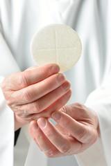 mani con eucaristia