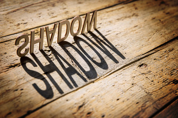 Wooden letters build the word shadow